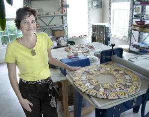 Ellen Mansfield with her ceramic mandala in process - photo by Sam Yu